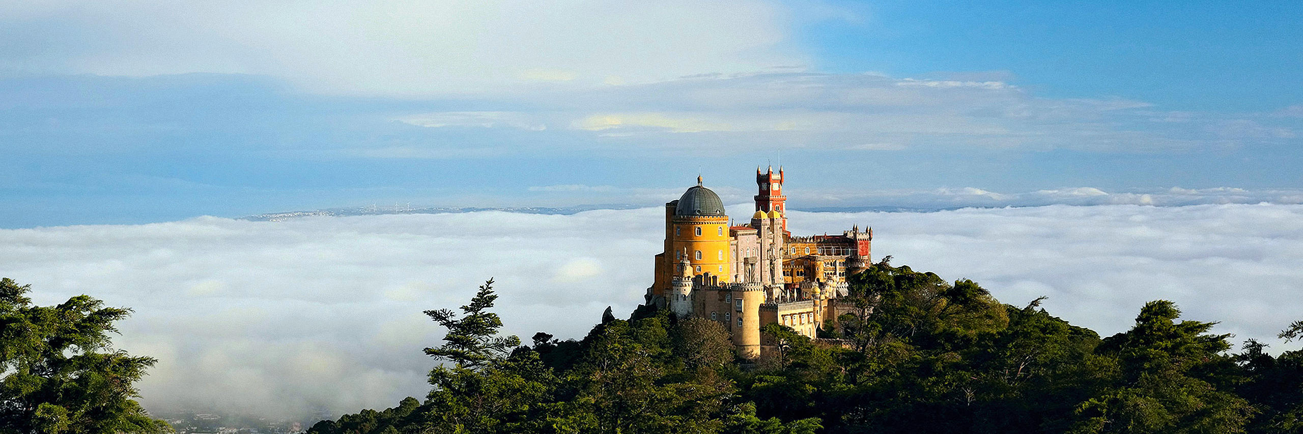 Birdview of Pena Palace emerging from the clouds